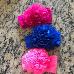 3 baby headbands . Elastic . Hot pink /blue/ pink